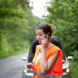 Young female driver, calling the roadside service/assistance — Stock Photo #8666388