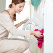 Housework: young woman doing laundry — Stock Photo #8666470