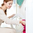 Housework: young woman doing laundry — Stock Photo #8666477