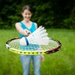 Pretty, young woman playing badminton in a city park — Stock Photo #8666539