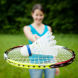 Pretty, young woman playing badminton in a city park — Stock Photo #8666547
