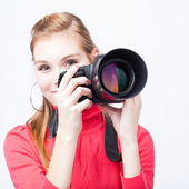 Pretty, female photographer with her digital camera — Stock Photo