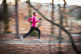 Young woman running outdoors in a city park — Stock Photo