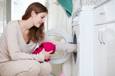 Housework: young woman doing laundry — Stok fotoğraf