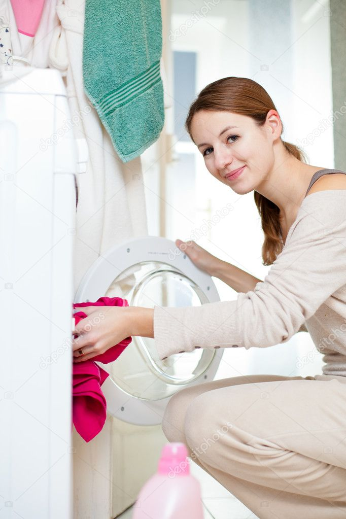 Housework: young woman doing laundry (shallow DOF; color toned image) — Stock Photo #8666483