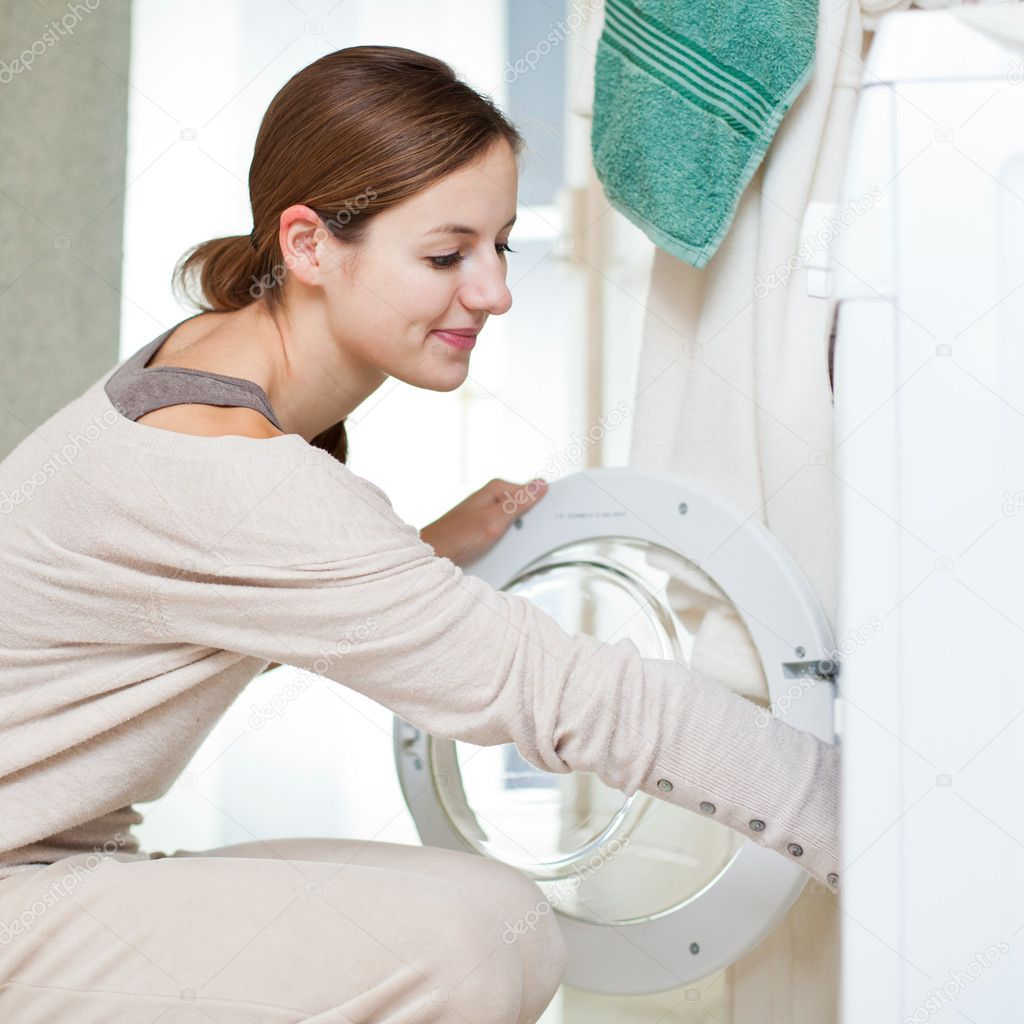 Housework: young woman doing laundry (shallow DOF; color toned image) — Stock Photo #8666491