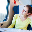 Stock Photo: Young woman traveling by train