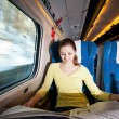 Young woman traveling by train — Stock fotografie