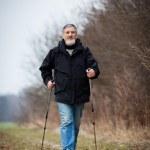 Senior man nordic walking — Stock Photo