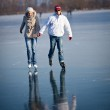 Couple ice skating outdoors on a pond on a lovely sunny winter day — Stock Photo #8874289