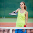Pretty, young female tennis player on the tennis court — Stock Photo #8874321
