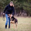 Master and her obedient dog — Stock Photo #8874345