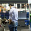 Young man fueling his car at the gas station — Stock Photo #8874350