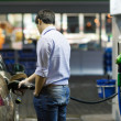 Young man fueling his car at the gas station — Stock Photo