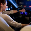 Woman driving his modern car at night in a city — Stock Photo #8874360