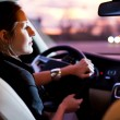 Woman driving his modern car at night in a city — Stock Photo #8874362