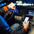 Man driving his modern car at night in a city — Stock Photo #8874381