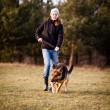 Master and her obedient dog — Stock Photo #8874385