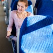 Young woman using her tablet in train — Stock Photo #8874396