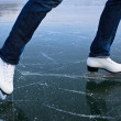 Young woman ice skating outdoors on a pond on a freezing winter - Stock Photo