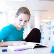Female college student in a library — Stock Photo #9115300