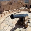 Old canon on the top of the Nakhl Fort - Stock Photo