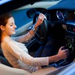 Pretty young woman driving her brand new car — Stock Photo #9115479