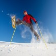Young man having fun while snowshoeing outdoors — Stock Photo #9115490