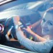 Pretty young woman driving her brand new car — ストック写真