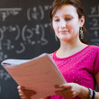 Student by the blackboard during a math class — Stock Photo