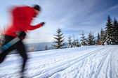 Cross-country skiing: young man cross-country skiing — Stok fotoğraf