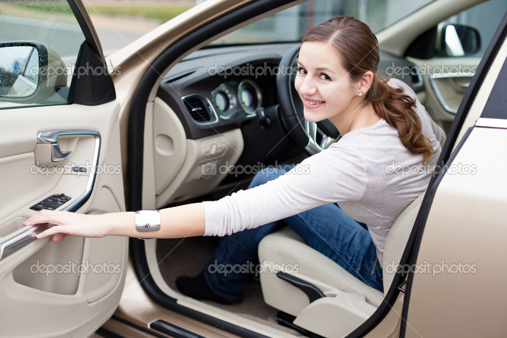 Pretty young woman driving her new car — Stock Photo #9115244