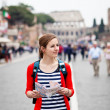 Pretty young female tourist holding a map in Rome — Stock Photo #9269799