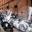 Row of motorbikes and scooters parked — Stock Photo #9269883