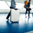 Royalty-Free Stock Photo: With their suitcases walking along a corridor