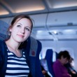 Pretty young female passenger on board of an aircraft — Stock Photo #9269932