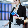 Pretty young female passenger at the airport — Stock Photo #9269976