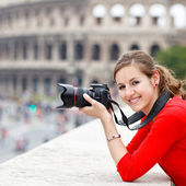 Portrait of a pretty young tourist taking photographs — Stok fotoğraf