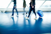 With their suitcases walking along a corridor — Stock Photo