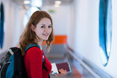 Portrait of a young woman boarding an aircraft — Stock Photo