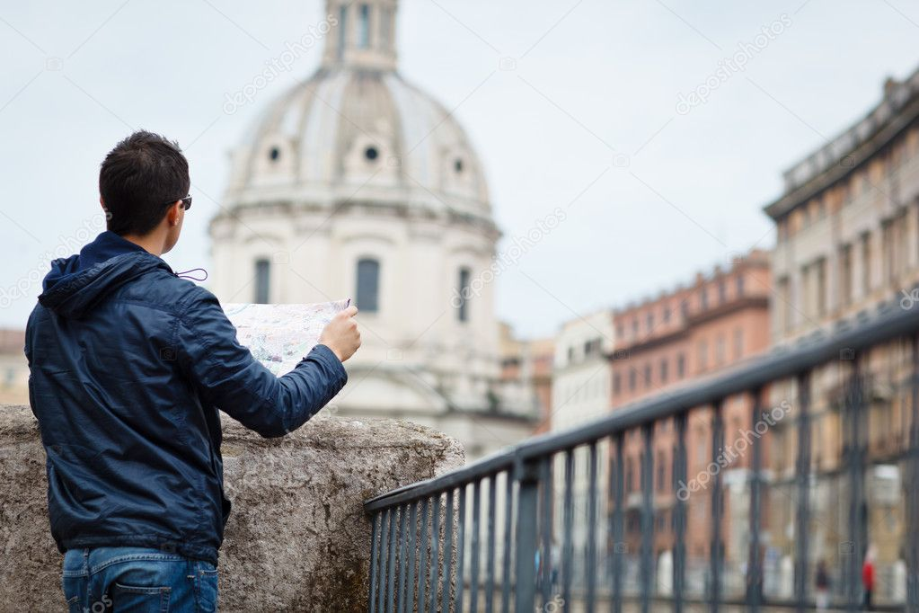 Portrait of a handsome, young, male tourist in Rome, Italy (dome of the Santissimo Nome di Maria church in the background)  Stock Photo #9269771
