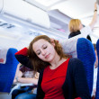 Pretty young female passenger on board of an aircraft — Stock Photo #9270017