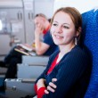 Pretty young female passenger on board of an aircraft — Stock Photo #9270027