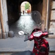 Scooter parked in one of the ancient streets of Rome — Stock Photo #9270034