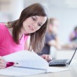 Pretty female student in the library — Stock Photo #9388857