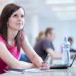 Pretty female student in the library — Stock Photo #9388872