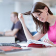 Pretty female student in the library — Stock Photo #9388894