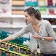 Pretty, young woman shopping for fruits and vegetables — Stock Photo #9388915