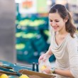 Pretty, young woman shopping for fruits and vegetables — Stock Photo #9388961