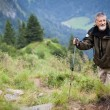 Active senior hiking in high mountains (Swiss Alps) — Stock Photo #9389015
